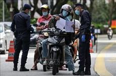 Malasia aumenta multas para personas cometidas de reglas contra COVID-19