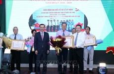 Honran a personas con destacados méritos en labores sobre vietnamitas en extranjero