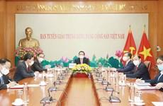 Comisiones de Partidos de Vietnam y Laos intensifican cooperación