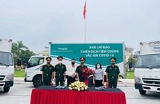Movilizan camiones refrigerados para transporte de vacunas en Vietnam