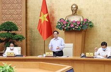 Gobierno de Vietnam analiza situación socioeconómica y respuesta al COVID-19