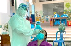 Los nuevos contagios del COVID-19 siguen superando 12 mil en Vietnam