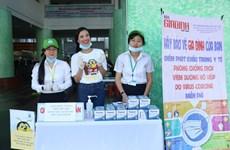 [Foto] La finalista Kim Duyen se unió a la comunidad en prevención contra la pandemia COVID-19