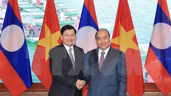 Vietnam y Laos decididos a fomentar la cooperación integral