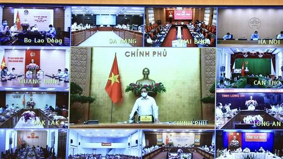 Primer ministro de Vietnam insta a garantizar la seguridad y salud de la población ante COVID-19