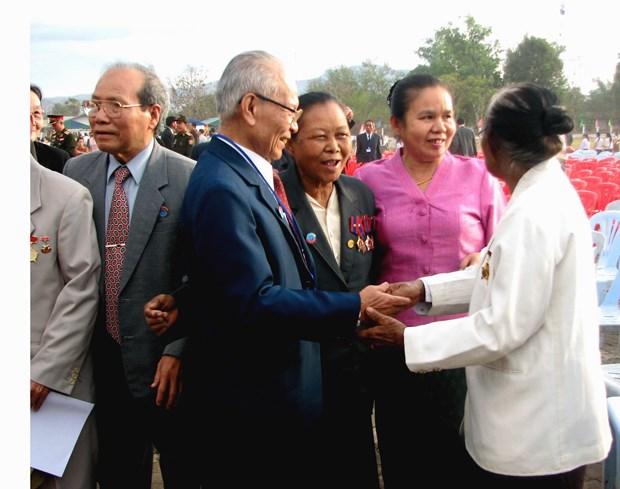 El aniversario 70 del Dia tradicional de soldados y expertos voluntarios vietnamitas en Laos hinh anh 7