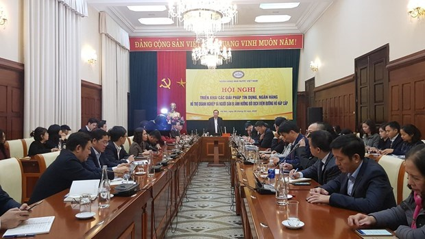 Bancos vietnamitas reducen tasas de interes para apoyar a empresas afectadas por el COVID-19 hinh anh 1