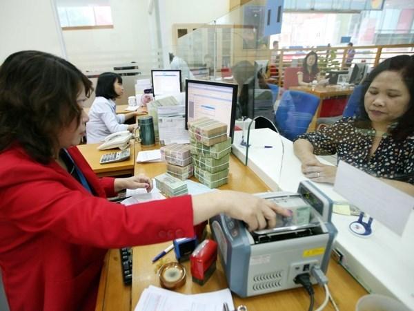 Bancos vietnamitas reducen tasas de interes para apoyar a empresas afectadas por el COVID-19 hinh anh 2