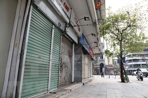 Vietnam disena politicas para recuperar mercado laboral afectado por COVID- 19 hinh anh 2
