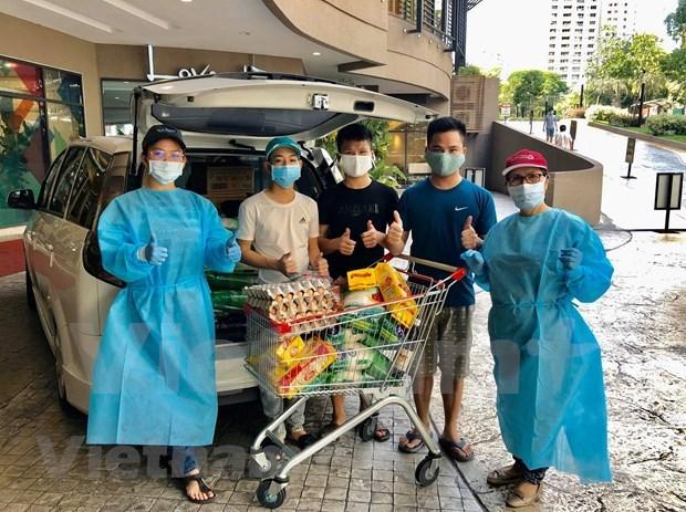 Apoyan a connacionales vietnamitas en Malasia en combate antiepidemico hinh anh 2
