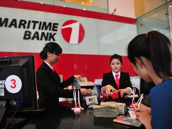 Banco Estatal de Vietnam decide fusion de MDB a Maritime Bank hinh anh 1