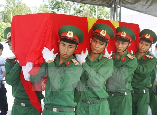 Repatrian restos de combatiente vietnamita caido en Laos hinh anh 1