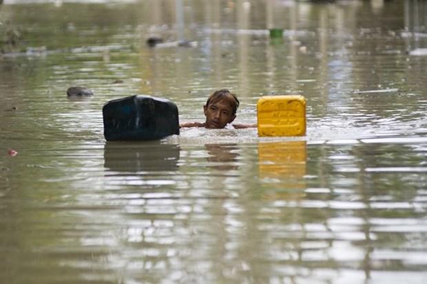 Complicada situacion en paises asiaticos por inundaciones hinh anh 1