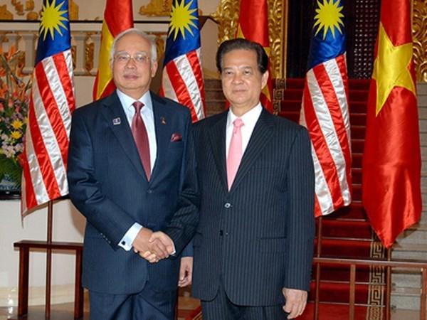 Vietnam impulsa nexos de cooperacion con Malasia y Singapur hinh anh 1