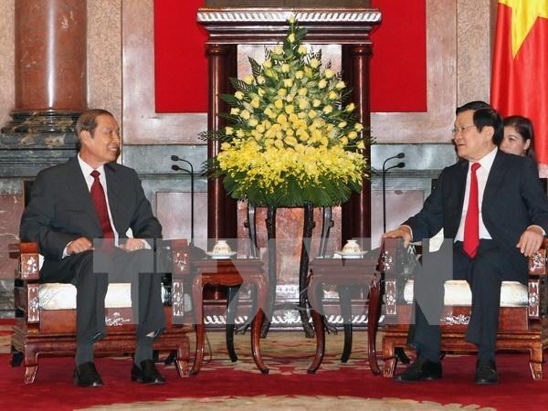Recibe presidente vietnamita a dirigente laosiano hinh anh 1