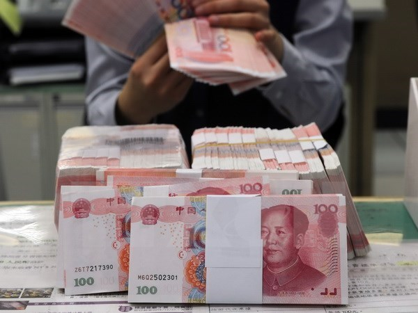 Presion de tasa cambiaria ante devaluacion de yuan hinh anh 1