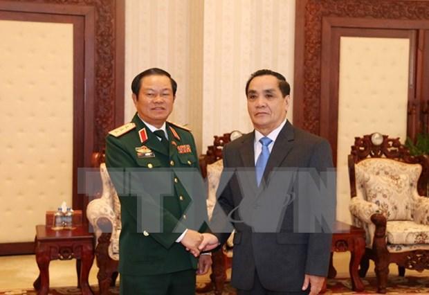 Alaba premier laosiano efectiva cooperacion militar con Vietnam hinh anh 1