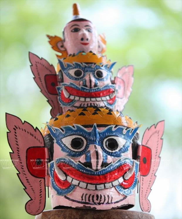 Empenado khmer en conservar valor de misteriosas mascaras hinh anh 12