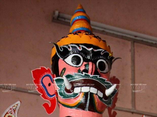 Empenado khmer en conservar valor de misteriosas mascaras hinh anh 13