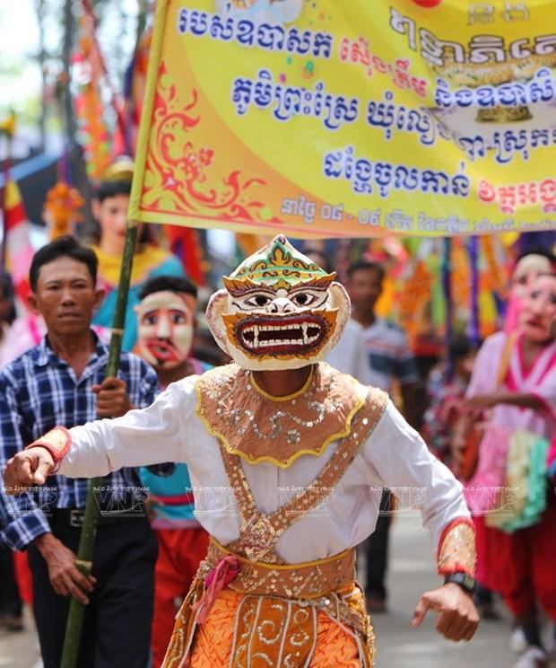 Empenado khmer en conservar valor de misteriosas mascaras hinh anh 7
