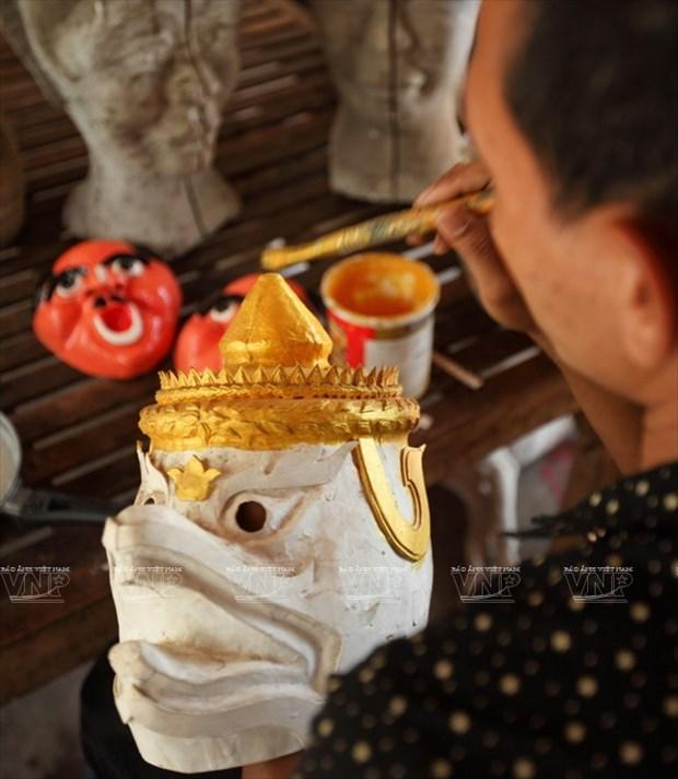 Empenado khmer en conservar valor de misteriosas mascaras hinh anh 4