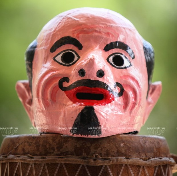 Empenado khmer en conservar valor de misteriosas mascaras hinh anh 9