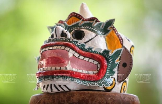 Empenado khmer en conservar valor de misteriosas mascaras hinh anh 11