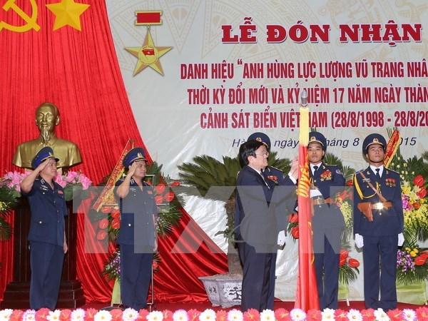 Policia Maritima recibe titulo de Heroe de Fuerzas Armadas Populares hinh anh 1