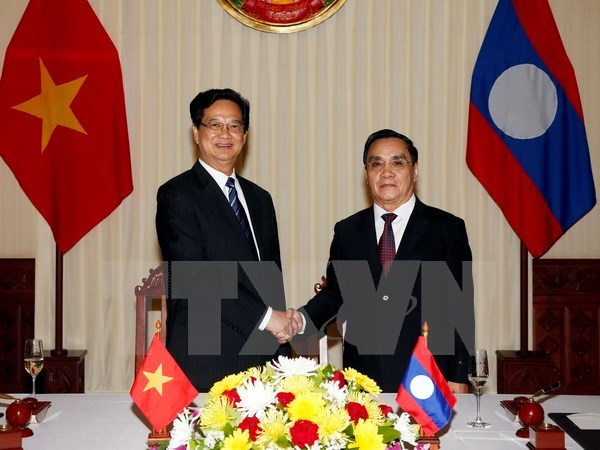 Visita del premier a Laos contribuye a robustecer nexos bilaterales hinh anh 1