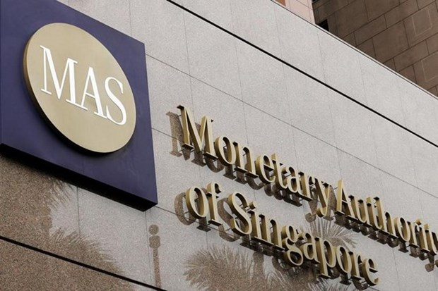 Singapur afloja politica monetaria para crecimiento economico hinh anh 1