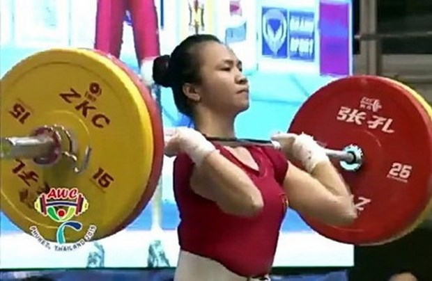 Halterofilia vietnamita gana cuatro medallas en torneo mundial hinh anh 1