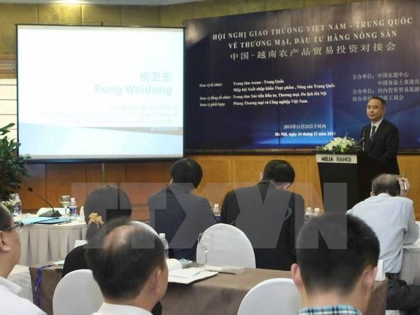 Encuentro entre Vietnam y China para intercambio comercial hinh anh 1