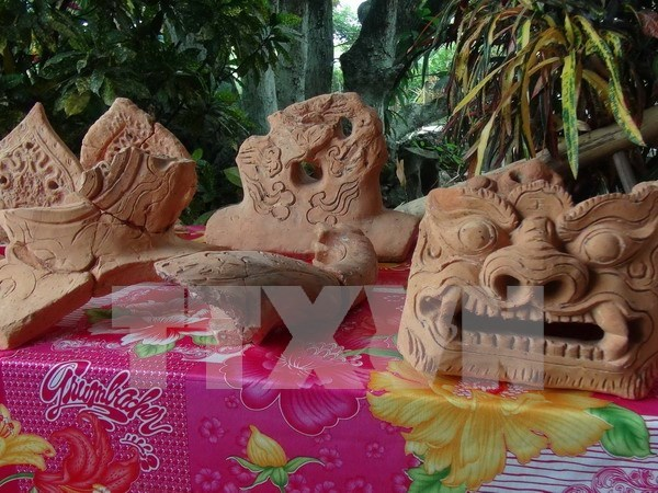 Descubren en Vietnam nuevos objetos del palacio real perdido hinh anh 1