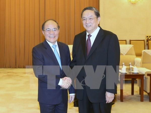 Titular parlamentario vietnamita dialoga con lider de organizacion china de masas hinh anh 1