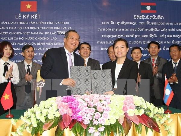 Apoya Vietnam a Laos construccion de centro de rehabilitacion a invalidos de guerra hinh anh 1