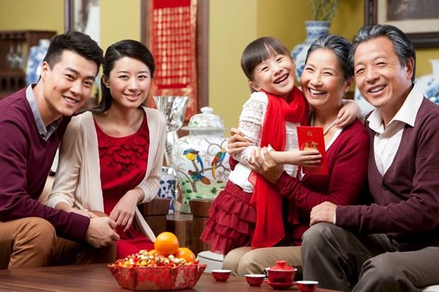 Reuniones familiares en ocasion del Tet despiertan conciencia de los origenes hinh anh 1