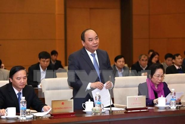 Parlamento vietnamita escruta informe de trabajo de gobierno y premier hinh anh 1