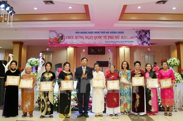 Vietnamitas en Laos conmemoran Dia Internacional de la Mujer hinh anh 1