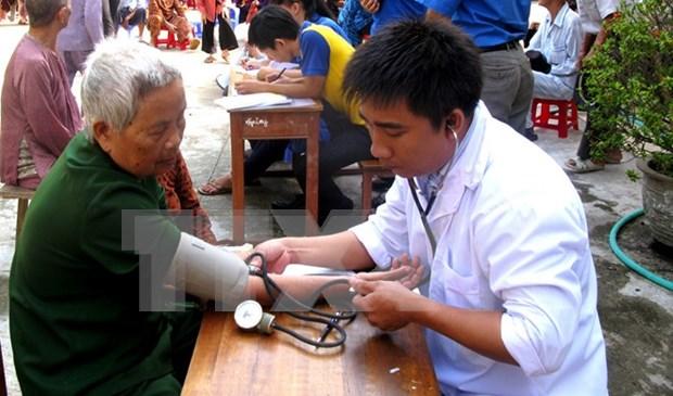 Vicepremier resalta esfuerzos por ampliar seguros medico y social para ancianos hinh anh 1