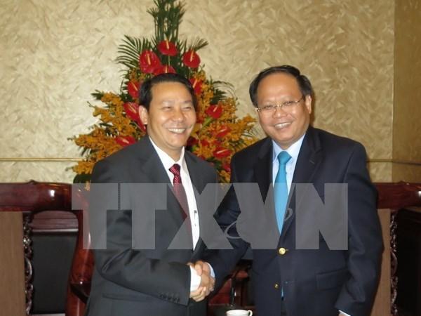 Promueven cooperacion entre Ciudad Ho Chi Minh y territorio laosiano hinh anh 1