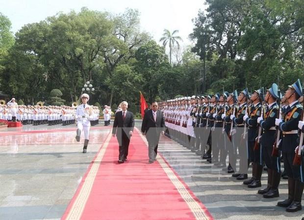 Nuevo presidente laosiano recibido en Hanoi hinh anh 1