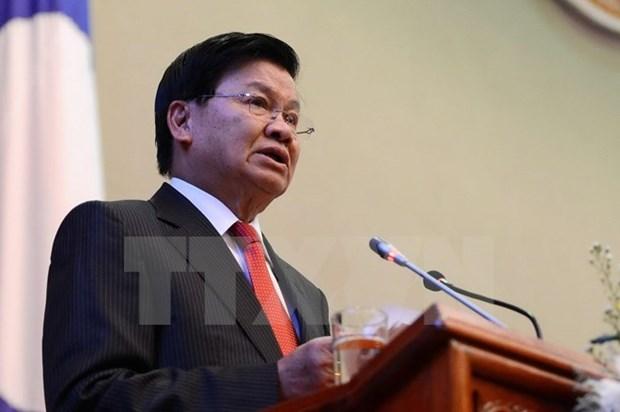Primer ministro de Laos inicia visita a Vietnam hinh anh 1
