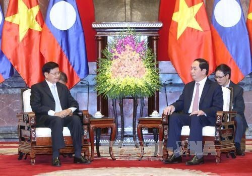 Presidente vietnamita recibe al primer ministro de Laos hinh anh 1