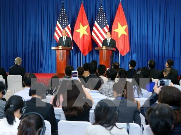 Presidentes vietnamita y estadounidense copresidieron rueda internacional de prensa hinh anh 1