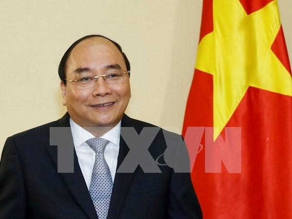 Prensa nipona entrevista a premier vietnamita antes de visita a Japon y cumbre deG-7 hinh anh 1