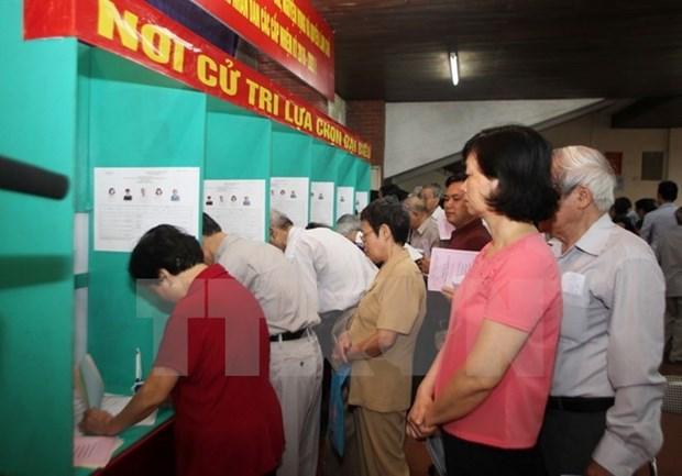 Periodico laosiano desenmascara complots de fuerzas hostiles contra Vietnam hinh anh 1