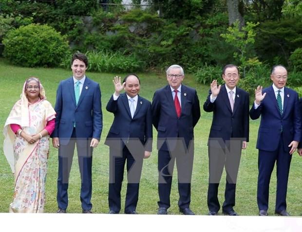 Premier vietnamita se reune con lideres mundiales en Cumbre ampliada de G7 hinh anh 1