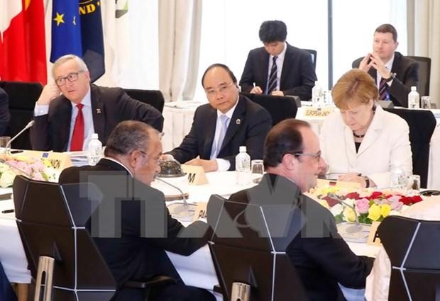 Destacan significado de visita a Japon y asistencia de premier vietnamita a cita G7 hinh anh 1