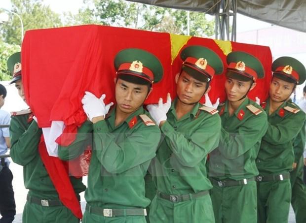Vietnam y Laos cooperan en busqueda de restos de combatientes hinh anh 1