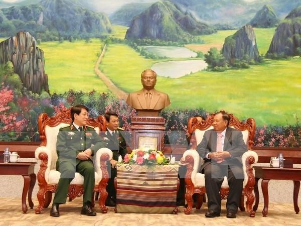 Lider laosiano promete respaldar cooperacion militar con Vietnam hinh anh 1